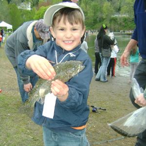boy grin fish